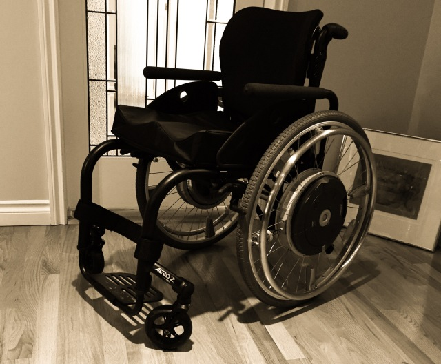 Sepia-tone photo of black TiLite AeroA wheelchair with e-motion wheels